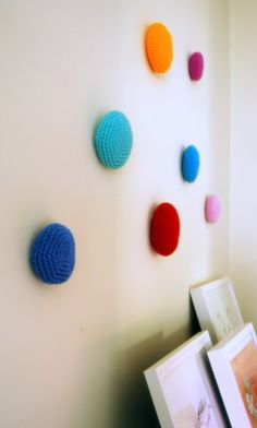 Adding modern texture and pops of color, these Crochet Wall Dots ($33) are a fun alternative to traditional...
