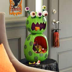 Create this adorable Monster Treat Pumpkin to hold sweets or treats for Halloween