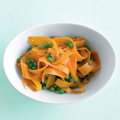 "Thanks ""Martha""...Carrot ribbons makes for a fancy presentation for plain old peas and carrots.  Get really fancy and garnish with some curls of shaved parmigiano!  And snipped chives and/or mint."