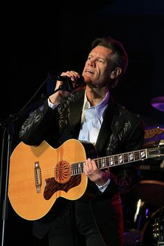 Randy Travis - seen him 9 times from 1986 to 2008.  Yeah, a little obsessive.