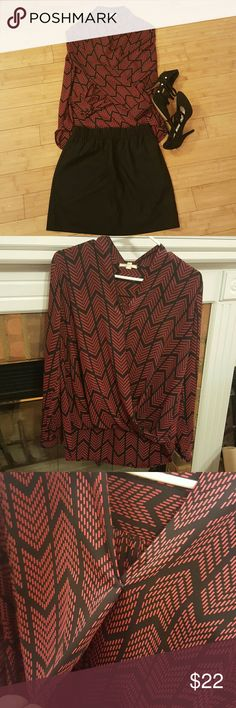 EUC Pleione wrap front shirt Red and black chevron print. This shirt was worn twice, in excellent condition. Bought at Nordstrom. Perfect shirt to wear to the office and then out for a drink or dinner afterwards. TTS medium. Has button closure at the bottom of neckline. Would be best to wear a cami underneath just in case. The back is lower while the front hemline is meant to be rolled up. Pleione Tops Blouses
