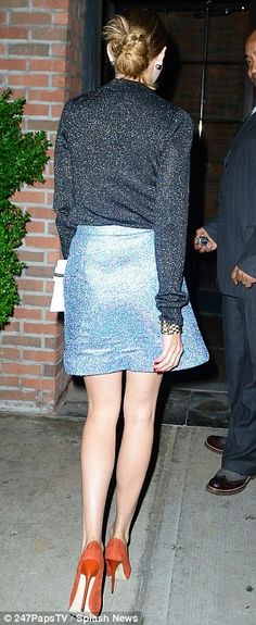 Long legs: Olivia showcased her leans pins in the short light blue dress