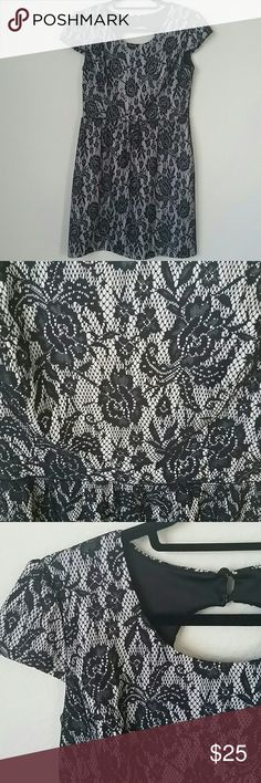 Keyhole back black and white lace dress Black and white lace dress with small cap sleeves and a beautiful open back. Perfect church, homecoming, or party dress! Great condition. Fits medium/large Dresses