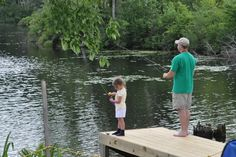 Fishing from the dock on Peqwuaket Pond  Conway NH
