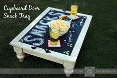 Cheap Decorating Ideas: Make a cute snack tray out of an old cabinet door.