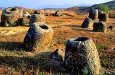 A grassy area studded with hulking, 2,000-year-old jars provides a surreal sight…