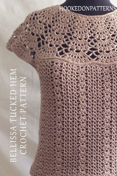 Bellissa Tucked Hem Top Crochet Pattern by Hooked On Patterns. An elegant crocheted short sleeved top. A perfect addition for your spring / summer wardrobe, or wear it layered over long sleeves for all year! #crochet #fashion #crochetpatterns #clothes #style #DIYCrafts #Hobby #HoP #crochettop