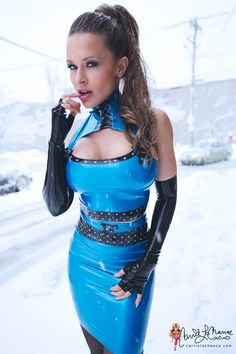 How anybody could be this hot in the freezing cold is truly beyond me but Carrie LaChance pulls it off. She's wearing a gorgeous blue latex dress from Westward Bound and a pair of sexy black …