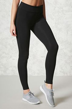 A pair of knit leggings featuring a foldover waistband, a high-rise, and constructed in a stretch-performance fabric.