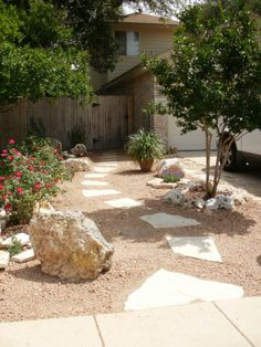 Xeriscaping project. Rocks, flagstone, decomposed granite, knockout roses...