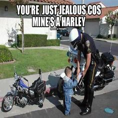 Wouldn't you love to know the story behind this cute kid & cop?