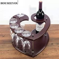 This eco-friendly heart-shaped wood wine caddy is perfect for displaying your wine bottle and glasses for Set the mood for your next date night.