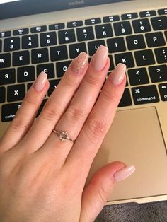 Nude and sparkle accent short coffin nails