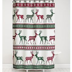 Boasting a bold reindeer and snowflake pattern with cheery bands of red and green, the polyester Nordic Shower Curtain brings a splash of seasonal color and style to your décor. Includes coordinating snowflake hooks.