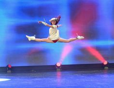 Rangerette Captain, Emily Diehl, of the 74th line, performs a split leap at the 75th Anniversary Extravaganza of the Kilgore College Rangerettes. April 18, 2015. Photo credit: Richard Sandoval