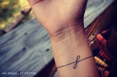 Simple Bracelet Tattoo. Instead Of A Letter It Could Spell Out A Name Positioned So That It Is Going Up The Arm