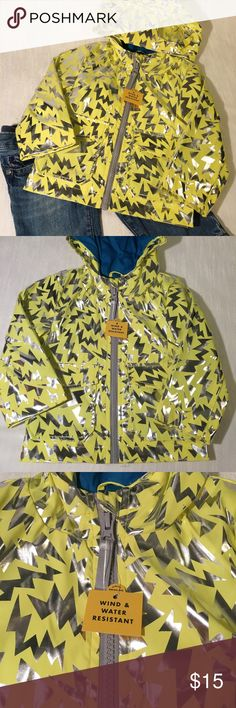 Cat & Jack Toddler Rain Jacket Size 12 Month NWOT Cat & Jack Toddler Rain Jacket  Size 12 Month 100% Polyester Lining and Exterior This jacket is so stinkin cute!! The jacket has two snap pockets, a fold down eye mask that snaps back to the top of the hood. Jacket is fully lined and has tag attached noting that jacket is wind and water resistant.   Thank you for sharing! Please reach out with any questions. Cat & Jack Jackets & Coats Raincoats