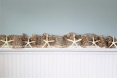"""Beach Christmas decor starfish garland using cool BROWN nautical decor netting with bonus GOLD SPARKLE and large 4-6"""" real white starfish. A nice long 10 foot size too!  Coastal decor wedding or Christmas garland, totally wired throughout so you can shape it however you'd like around anything.  The addition of the GOLD SPARKLE of tinsel woven throughout makes it extra festive and beautiful with white lights!"""