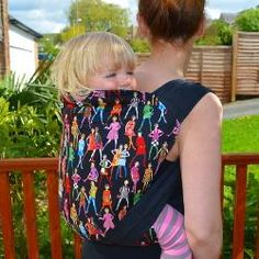 The Mei Tai is a comfortable ergonomic baby carrier. Apanel of fabric with a tied waistband and long shoulder straps which tie baby securely to the wearers cen