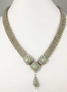 MadDesigns - quattro cupole necklace - love the way the beads are captured.