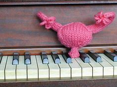 Piano-playing uterus.  (slide show of naughty knits; why not send one to your congressman today?) #the_frisky