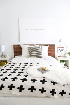 An Ikea headboard gets a custom look with this how-to. #IKEAhack | You don't really need an IKEA headboard to start with though. Could also be painted plywood I guess.