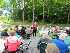 Reverend Jacqueline Schmitt gives sermon at outdoor service.