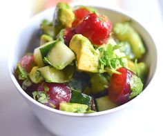 So hydrating and yummy on a warm day! It's a superfood extravaganza! And it's GF and vegan! Raw Cucumber Avocado Red Grape Salad on thekitchengirl.com