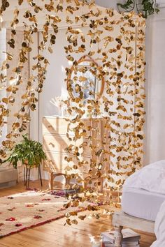 Shop Gold Decorative Petal Garland at Urban Outfitters today. My New Room, My Room, Teen Room Decor, Bedroom Decor, Urban Outfitters, Aesthetic Room Decor, Boho Living Room, Bedroom Inspo, Bedroom Ideas