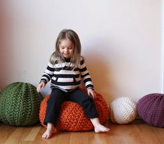 Hand knitted soft & lightly fuzzy wall-acrylic blended pouf with soft polyester filling, which is rounder and squishes more like a traditional pillow. These are great to use in a baby's room or kid's room, or as a grouping of floor pillows in a relaxing space.