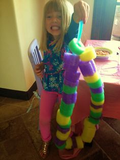 Playful Creations: Noodle Fun Cutting up a pool noodle creates many playful activities, like this one.
