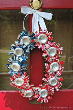 4th of July Recycled Can Wreath. A lovely wreath made from recycled soda cans. Cool idea for patriotic holiday. http://hative.com/diy-patriotic-wreath-ideas-for-4th-of-july-or-memorial-day/