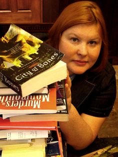 Cassandra Clare. I promise to have a collection of your books, as for now I am enjoying the ebooks.