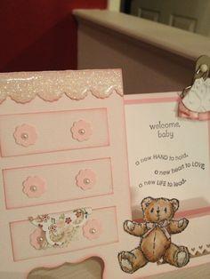 Side-step dresser baby card