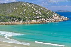 The amazing shallow and aqua coloured water at Picnic Bay - you can see a few people waiting for a break, though Wilsons Prom is not know for its surfing. This photo was taken from the lookout between Picnic and Whisky Bays. Wilsons Promontory, Aqua Color, Countries Of The World, Places Ive Been, Picnic, Surfing, To Go, Places To Visit, Tropical