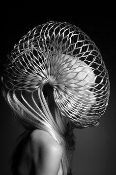 Alien ... Her Head is shaped like a  Slinky.