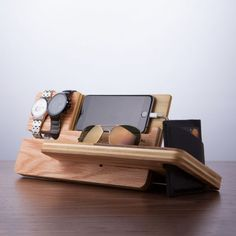The Universal Smart Phone Eye and Watch Dock Valet is minimalistic and feature-rich solution to both charge and display your phone no matter where its charge port is. Perfect to use with an alarm clock app on a nightstand, it boasts an integrated . Wood Projects, Woodworking Projects, Support Telephone, Docking Station, Everyday Objects, Desk Organization, Gifts For Him, Wood Crafts, Diy Crafts