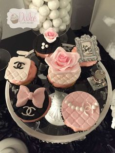 Fondant topped cupcakes at a Chanel birthday party! See more party planning ideas at CatchMyParty.com!