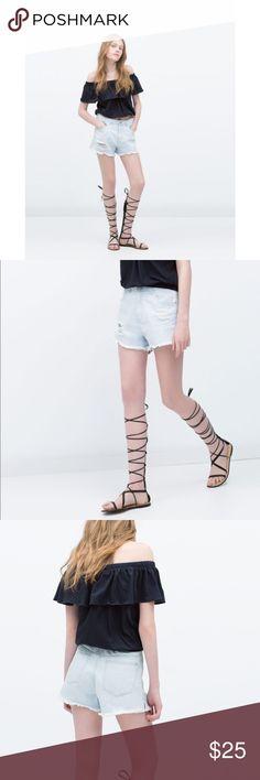 Light Wash Denim Shorts High waist denim shorts in light blue wash  Ripped Detail with Frayed hem.  Material: Cotton NWT.  Size 8 (EU 40)  *No trades / No low-ball offers *Be respectful   -Txs! Zara Shorts Jean Shorts