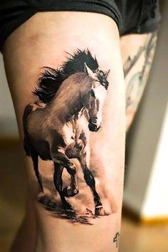 Beautiful running wild white horse tattoo on the thigh.