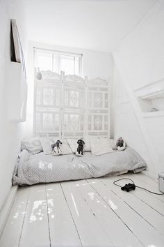 Clean white room with a cozy nook