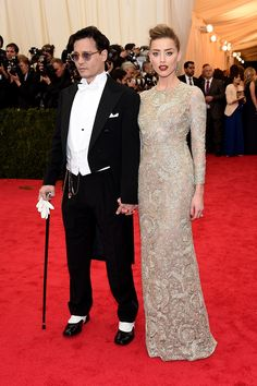 Vogue Daily — Johnny Depp in Ralph Lauren Black Label and Amber Heard in Giambattista Valli