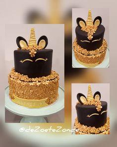 Black and gold unicorn cake