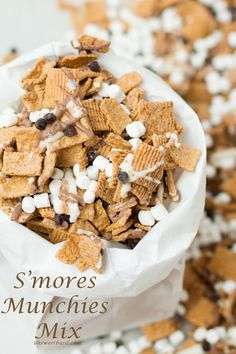 Golden grahams, chocolate and mini marshmallows make the best s'mores munchies mix I've ever eaten!!!