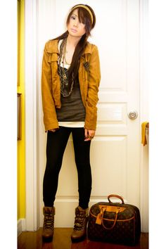 Well matched mustard coloured jacket and leggings. Louis Vuitton Deauville handbag.
