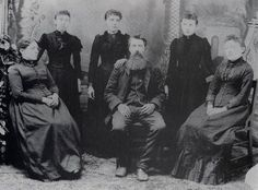 Family photo of Laura Ingalls Wilder:  seated (from left) are Caroline, Charles, and Mary.  Standing (from left) are Carrie, Laura, and Grace.