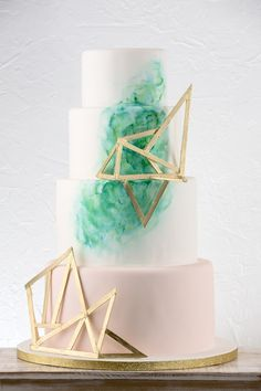 If a geometric decadent cake is what you're wanting for a wedding cake then the Frosted Affair is for you! This one is a gem! Click the image for more information. Photo credit: Billingsley & Company