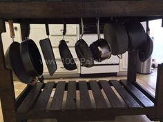 Kitchen island from pallets with locking castor wheels.  Love hanging the pots underneath.