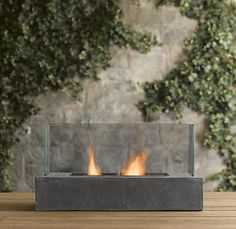 love these contemporary fireplaces