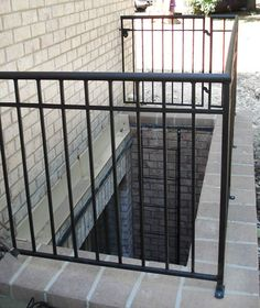 A custom emergency window well guard railing with a latter for a commercial property fabrication and installation. Basement Windows, Walkout Basement, Egress Window, Iron Windows, Basement Lighting, Window Well, Types Of Fences, Outdoor Stairs, Deck Railings